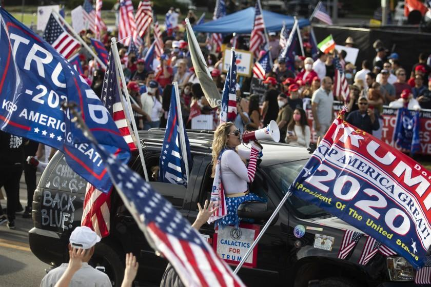 """LOS ANGELES, CA - OCTOBER 31: A large crowd chants """"four more years"""" during a Pro Trump rally on Santa America Blvd and Beverly Blvd in Beverly Hills days before the Presidential election. on Saturday, Oct. 31, 2020. The crowd is large and very loud, but peaceful. (Francine Orr / Los Angeles Times)"""