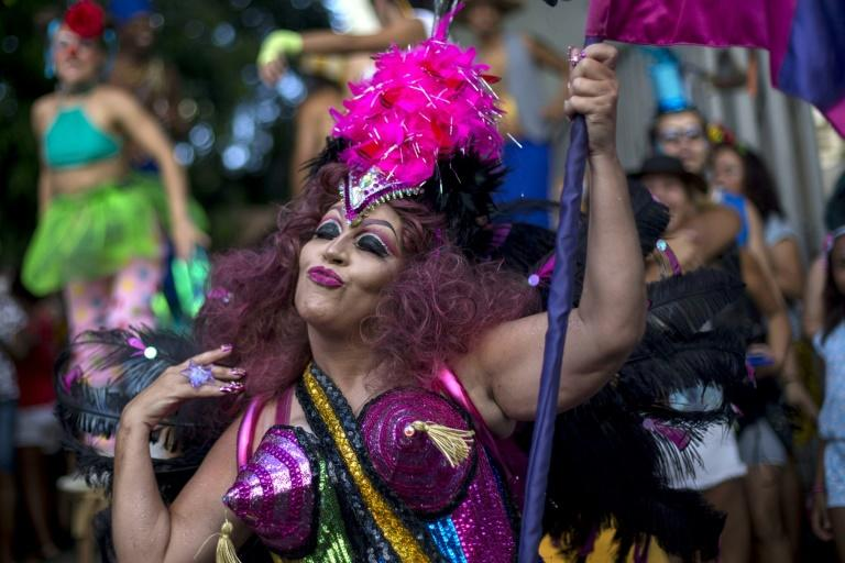 "Revellers celebrate the street carnival parade of the ""Loucura Suburbana"" bloco in Rio de Janeiro, Brazil, on February 8, 2018"