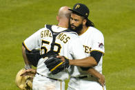 Pittsburgh Pirates relief pitcher Richard Rodriguez, right, hugs catcher Jacob Stallings after getting the final out of a baseball game against the San Diego Padres in Pittsburgh, Tuesday, April 13, 2021. The Pirates won 8-4.(AP Photo/Gene J. Puskar)