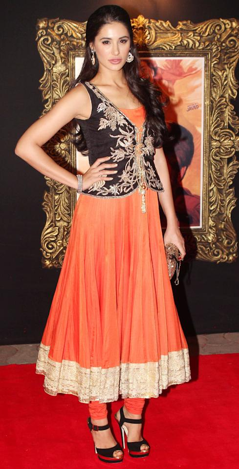 Nargis goes for an embroidered waistcoat instead of a traditional dupatta with her anarkali.