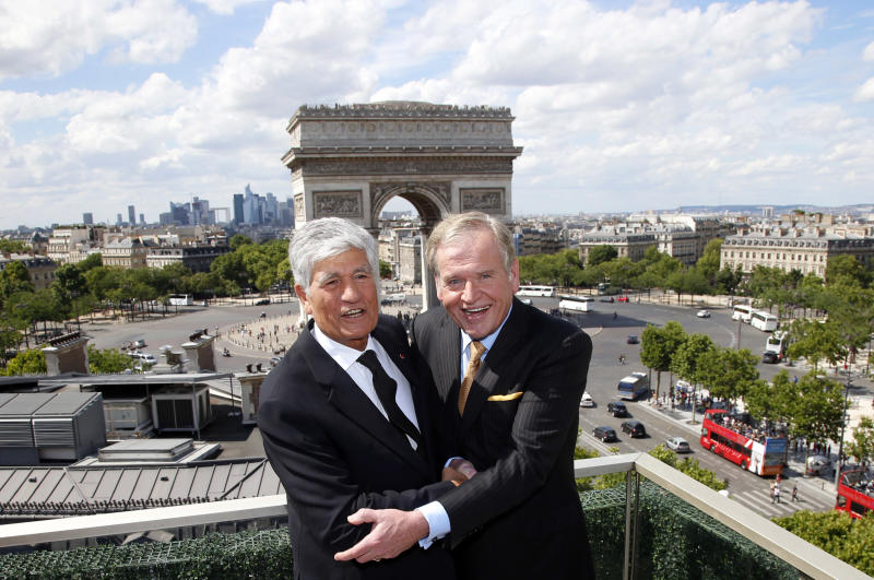 Maurice Levy, left, Chief Executive of French advertising group Publicis, and John Wren, head of Omnicom Group pose during a joint news conference in Paris, France, Sunday, July 28, 2013. Publicis and Omnicom have announced merger plans to create the world's biggest advertising group. (AP Photo/Francois Mori)