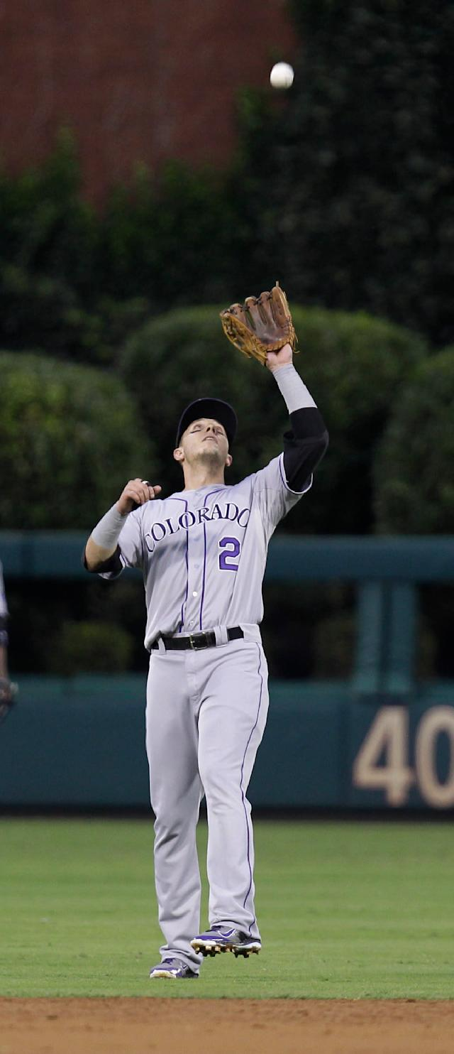 Colorado Rockies' Troy Tulowitzki makes the catch on a pop-up by Philadelphia Phillies' Cody Asche in the second inning in a baseball game, Wednesday, Aug. 21, 2013, in Philadelphia. (AP Photo/Laurence Kesterson)