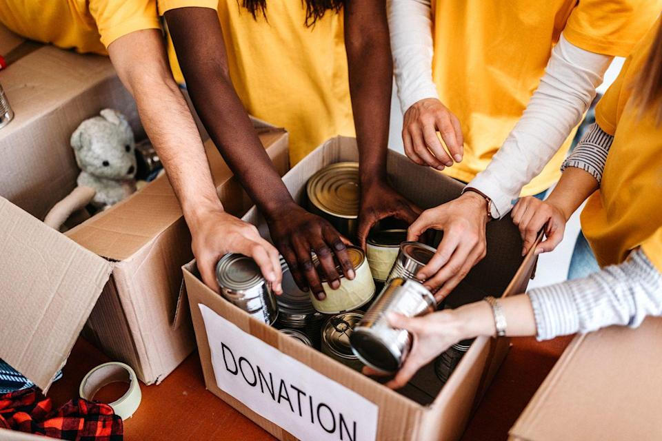 <p>It's only natural to demonstrate gratitude by trying to give back on Thanksgiving, but instead of volunteering at a soup kitchen—many of which are overrun on that single day, but then forgotten about later—why not invite your guests to each bring canned foods to donate? </p>