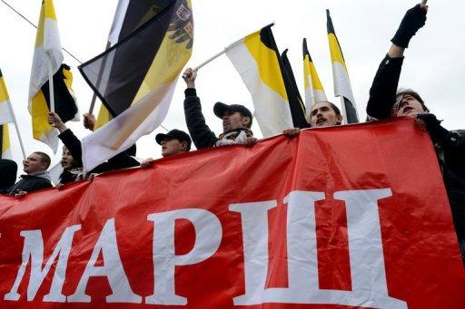 """<p>Russian ultra-nationalists wave pre-revolutionary flags and a banner as they take part in the so-called """"Russian March"""" in central Moscow on November 4 marking National Unity Day. """"We are the authorities, the authorities are us,"""" some participants shouted. """"Putin's clique to trial,"""" shouted others. """"We beat Hitler, we will beat Putin.""""</p>"""