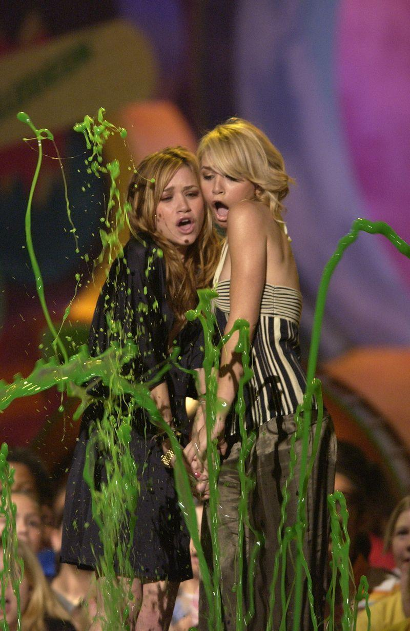 """<p>Are you even a celebrity if you haven't been slimed? Answer: no, obviously not. Much like being nominated for an Oscar, being slimed on Nickelodeon is a rite of passage every celebrity dreams of. Which probably explains why so many <em>acteurs</em> have allowed themselves to be drenched in green goop over the years. Here, we've rounded up 50 slimed celebs as part of an ongoing mission to preserve slime's legacy in American history books, but first, some fun facts. </p><ol><li>Per <a href=""""https://www.vice.com/en/article/kwp5e3/remembering-sliming-on-nickelodeon"""" rel=""""nofollow noopener"""" target=""""_blank"""" data-ylk=""""slk:Vice"""" class=""""link rapid-noclick-resp""""><em>Vice</em></a>, the very fist sliming happened on <em>You Can't Do That on Television </em>in 1979<em>. </em>Said slime was originally meant to be """"food slop"""" which grew """"eight inches of green crud."""" As producer Geoffrey Darby said, """"We had to get the scene. We couldn't get more slop… So we said, <em>Dump it on the kid anyway</em>."""" Wow, horrifying.</li><li>Nickelodeon got <em>rich</em> on slime. Aside from incorporating it into literally all their shows, they started manufacturing slime cereal, slime ketchup, and actual slime—aka Gak. Oh, <em>and</em> Nick hosts an annual Slime Fest. Like Coachella but for slime, ya know?</li><li>It's made from vanilla pudding and green food coloring. So yes, it turns out slime is delicious and I would, in fact, eat it.</li></ol><p>Obviously, slime > everything, but if you're wondering how celebs got involved, that'd be because of The Kids' Choice Awards, where A-list award winners often get slimed. TBD on if they know it's coming in advance (there was some debate about this on gossip account <a href=""""https://www.instagram.com/deuxmoi/?hl=en"""" rel=""""nofollow noopener"""" target=""""_blank"""" data-ylk=""""slk:@DeuxMoi"""" class=""""link rapid-noclick-resp"""">@DeuxMoi </a>recently), but judging from how many people look completely horrified, I'm going with no. On that note, onto our slimy celebs!</p>"""