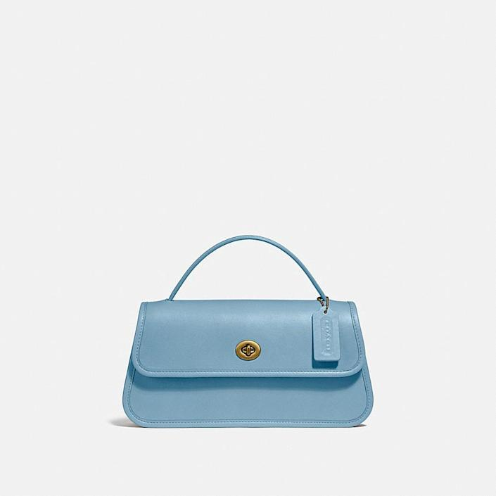 <p>The <span>Coach Turnlock Clutch</span> ($395) is so timeless and fun to wear.</p>