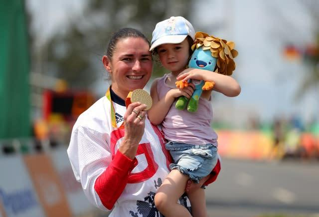 Great Britain's Sarah Storey celebrates winning gold at the Rio Olympics with her daughter (Andrew Matthews/PA)