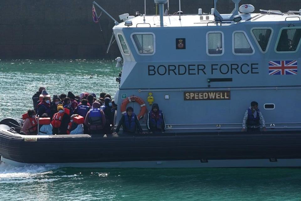 A group of people thought to be migrants are brought into Dover, Kent, by Border Force officers, following a small boat incident early this month (Jonathan Brady/PA) (PA Wire)