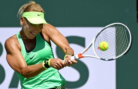 Mar 19, 2017; Indian Wells, CA, USA; Elena Vesnina (RUS) hits a shot as she defeated Svetlana Kuznetsova (not pictured) in the women's final in the BNP Paribas Open at the Indian Wells Tennis Garden. Mandatory Credit: Jayne Kamin-Oncea-USA TODAY Sports