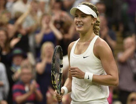Eugenie Bouchard of Canada reacts after defeating Alize Cornet of France in their women's singles tennis match at the Wimbledon Tennis Championships, in London June 30, 2014. REUTERS/Toby Melville