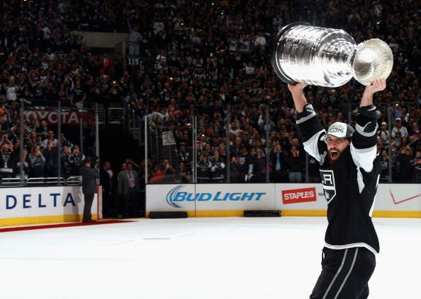 LOS ANGELES, CA - JUNE 13: Jarret Stoll #28 of the Los Angeles Kings lifts the Stanley Cup after his team won Game Five 3-2 in double overtime over the New York Rangers in the 2014 Stanley Cup Final at the Staples Center on June 13, 2014 in Los Angeles, California. The Kings won the game 3-2 and win the series 4-1. (Photo by Dave Sandford/NHLI via Getty Images)
