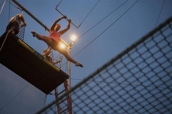 Nikki Dolenz practices on the trapeze at Trapeze School New York June 24, 2012.