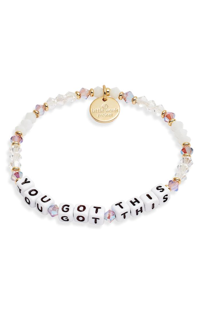 """<p><strong>LITTLE WORDS PROJECT</strong></p><p>nordstrom.com</p><p><strong>$20.00</strong></p><p><a href=""""https://go.redirectingat.com?id=74968X1596630&url=https%3A%2F%2Fwww.nordstrom.com%2Fs%2Flittle-words-project-you-got-this-stretch-bracelet%2F5760815&sref=https%3A%2F%2Fwww.goodhousekeeping.com%2Fholidays%2Fgift-ideas%2Fg4352%2Fhigh-school-graduation-gifts%2F"""" rel=""""nofollow noopener"""" target=""""_blank"""" data-ylk=""""slk:Shop Now"""" class=""""link rapid-noclick-resp"""">Shop Now</a></p><p>This wearable reminder will encourage her on the days she needs it most. It'll even offer just the right amount of sparkle and shine against her watch, bangles or other bracelets. </p>"""