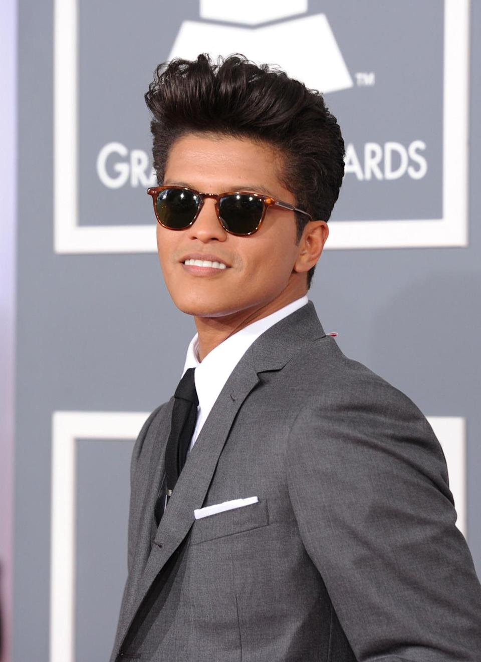 <p>With his pompadour, gleaming smile, and sunglasses, Bruno Mars is always iconic on the red carpet and stage — even before he starts dancing and singing.<i> (Photo: Getty Images)</i></p>