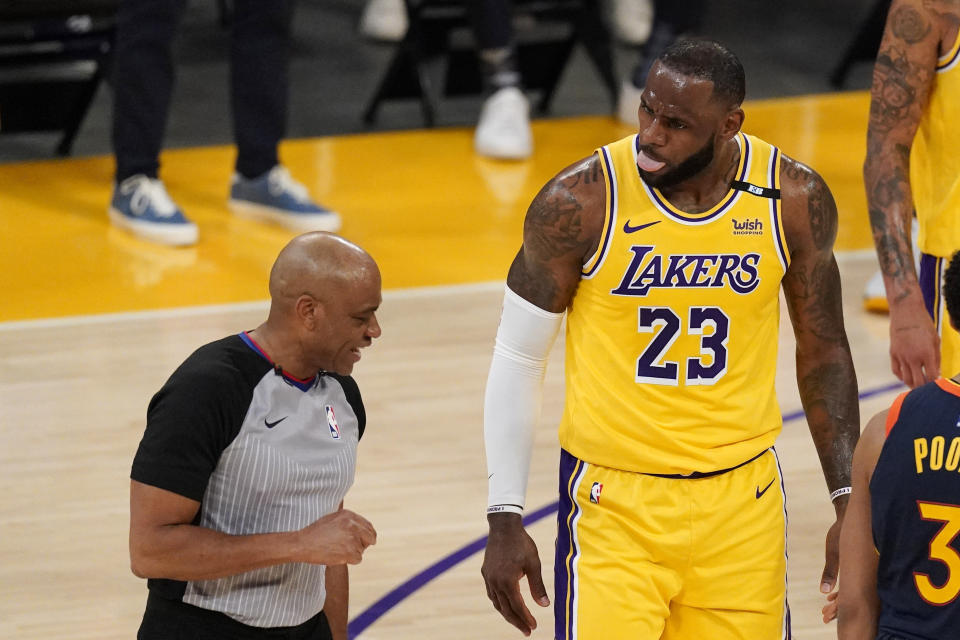 Los Angeles Lakers forward LeBron James, right, right, talks to a referee about a foul call during the first half of an NBA basketball Western Conference Play-In game against the Golden State Warriors Wednesday, May 19, 2021, in Los Angeles. (AP Photo/Mark J. Terrill)
