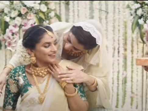 The advert which has been pulled showed a Muslim mother congratulating her Hindu daughter-in-law at a baby shower (Screengrab/Tanishq)