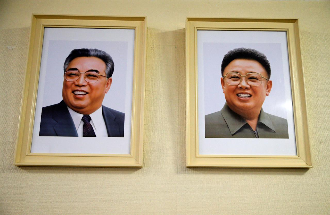 Portraits of Kim Jong Il and Kim Il Sung are displayed at the Permanent Mission of North Korea in Geneva, Switzerland, November 17, 2016. REUTERS/Denis Balibouse
