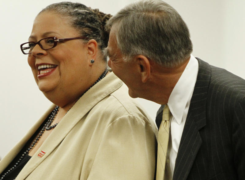 Chicago Teachers Union President Karen Lewis, left, is greeted by Chicago Board of Education President David Vitale at a Chicago Board of Education meeting on Wednesday, Aug. 22, 2012 in Chicago. The union has been locked in negotiations with the board, calling for fair contracts with higher pay for its teachers. (AP Photo/Sitthixay Ditthavong)