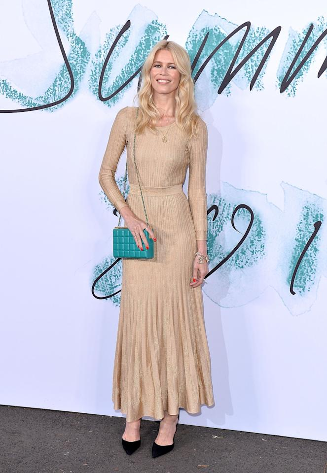 <p>The supermodel went for a subtle golden gown paired with a turquoise box clutch.<br /><i>[Photo: Getty]</i> </p>