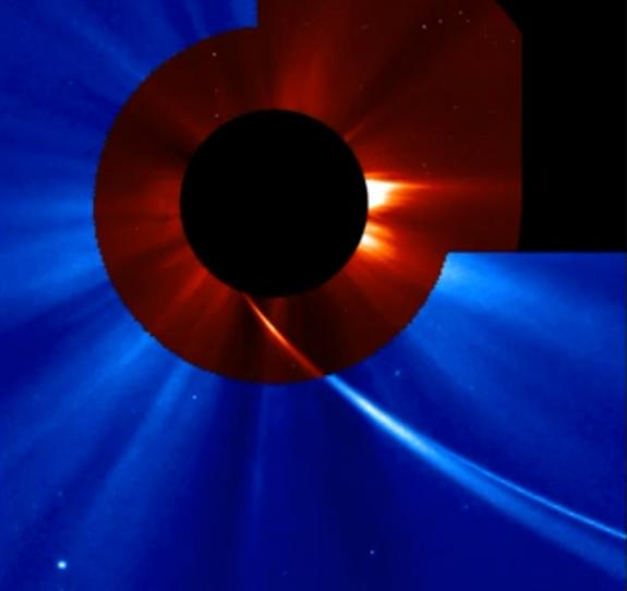 This image shows Comet ISON extremely close to the sun as seen by the SOHO spacecraft on Nov. 28, 2013 during the comet's Thanksgiving Day close solar encounter. The comet's long tail is seen sweeping back away from the sun.