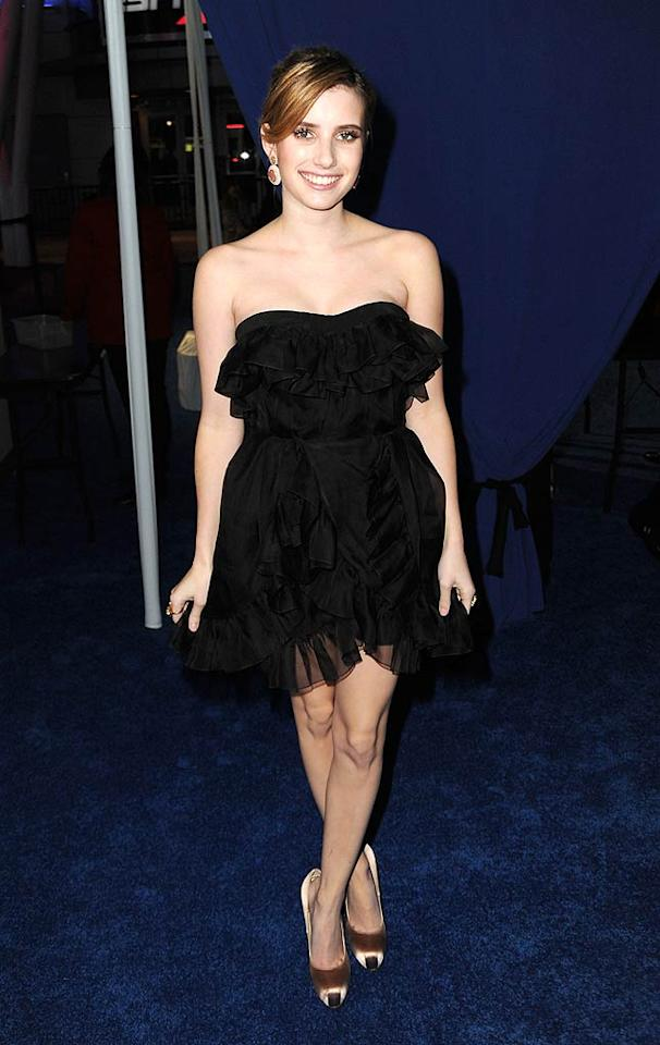 "New ""Scream"" queen Emma Roberts delivered her best ""Black Swan"" pose while wearing a ruffled chiffon mini and minimal makeup. Jeff Kravitz/<a href=""http://www.filmmagic.com/"" target=""new"">FilmMagic.com</a> - January 5, 2011"