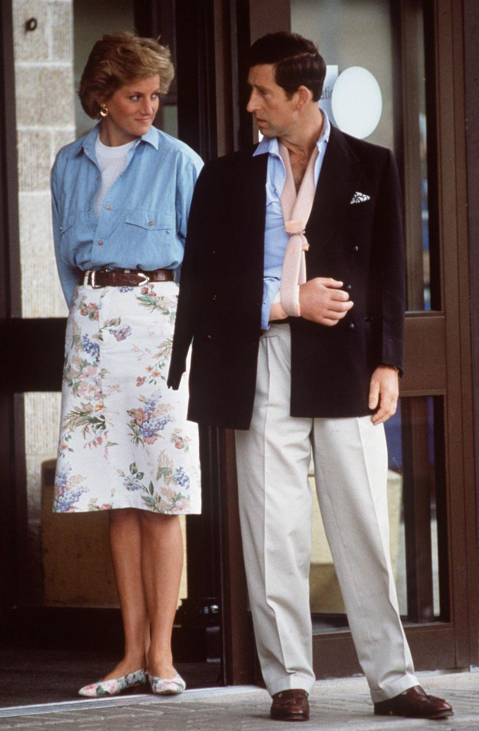 <p>Diana and Charles are pictured here together on her 29th birthday. She's got an epic matching floral skirt and flat combo going on, topped off with a chambray denim shirt. Complete with a thick leather belt, gold earrings, and a perfect tan, she always knew how to do casual glamour. </p>