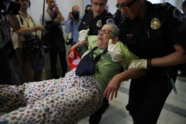 Protesters are removed from outside of Senate Majority Leader Mitch McConnell's office as they demonstrate against proposed cuts to Medicaid, June 22, 2017. (Photo: Jacquelyn Martin/AP)