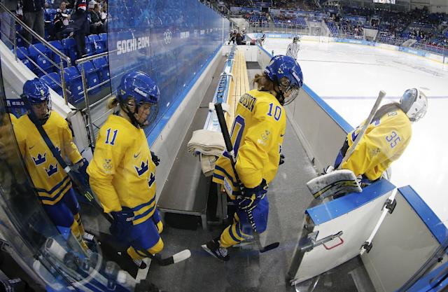 Team Sweden is led to the ice by Goalkeeper Valentina Wallner before the first period of the 2014 Winter Olympics women's semifinal ice hockey game against USA at Shayba Arena Monday, Feb. 17, 2014, in Sochi, Russia. (AP Photo/Petr David Josek)