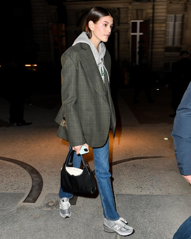 Blazer over a hoodie and New Balance 990s? Kaia Gerber has righteous dad style.