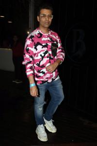 Karan Johar poses for photographers on his arrival at Bhumi Pednekar's birthday party in Mumbai. (Image: Viral Bhayani)