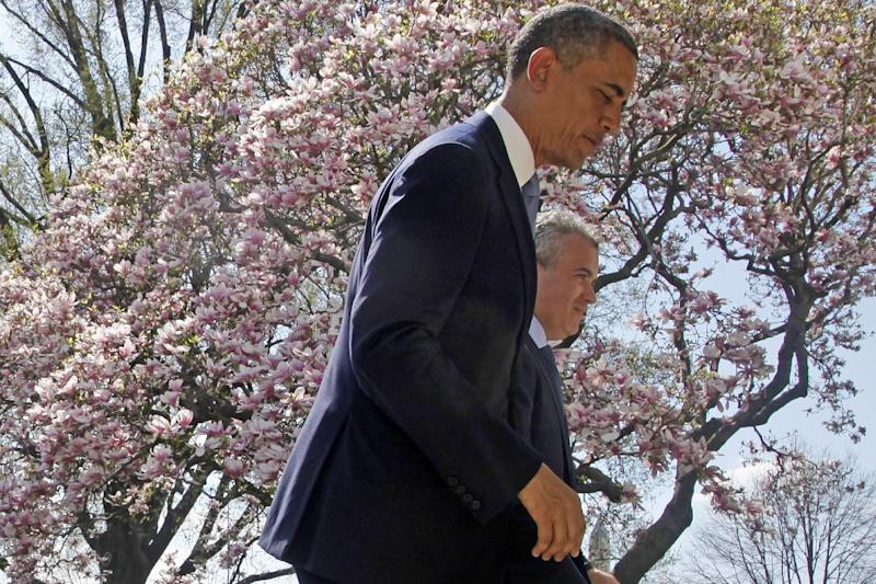"""FILE - In this April 10, 2013 file photo President Barack Obama and acting Budget Director Jeffrey Zients leave the Rose Garden of the White House in Washington after the president discussed his proposed fiscal 2014 federal budget. Presidents like to take credit for economic recoveries, just as Obama is angling to do now. He and his allies in Congress have """"walked the economy back from the brink,"""" his new 2014 federal budget blueprint asserts. And Democrats hope these improvements, while still slow and uneven, will give them at least a small boost in 2014's midterm races. (AP Photo/Charles Dharapak, File)"""