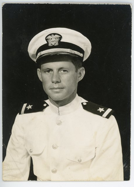 """From 1943, during World War II. A mid-20s Kennedy poses for a photograph in his Navy uniform. <a href=""""http://www.mcinnisauctions.com/"""" rel=""""nofollow noopener"""" target=""""_blank"""" data-ylk=""""slk:(Photo courtesy of John McInnis Auctioneers)"""" class=""""link rapid-noclick-resp"""">(Photo courtesy of John McInnis Auctioneers)</a>"""
