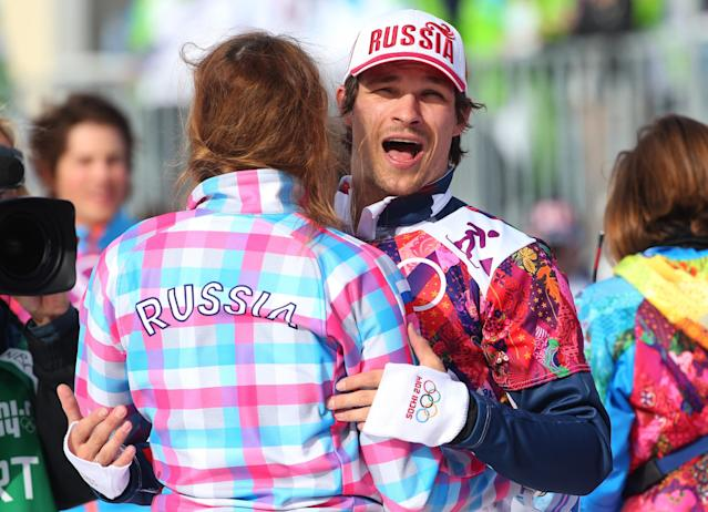 SOCHI, RUSSIA - FEBRUARY 22: Gold medalist Vic Wild of Russia celebrates celebrates with Alena Zavarzina of Russia after the Snowboard Men's Parallel Slalom Finals on day 15 of the 2014 Winter Olympics at Rosa Khutor Extreme Park on February 22, 2014 in Sochi, Russia. (Photo by Mike Ehrmann/Getty Images)