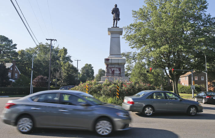 Cars pass by a statue of Confederate General A. P. Hill that was vandalized overnight in Richmond, Va., Wednesday, Aug. 22, 2018. Richmond has been debating what to do with its most prominent Confederate monuments along Monument Avenue in a different part of the city. The Hill statue hasn't been part of that discussion. (AP Photo/Steve Helber)