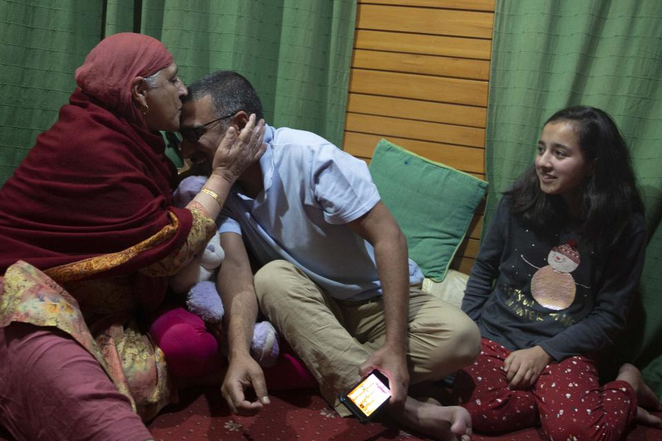 Associated Press photographer Dar Yasin celebrates with his family at his home in Srinagar, Indian controlled Kashmir, Tuesday, April 5, 2020, following the announcement that he was one of three AP photographers who won the Pulitzer Prize in Feature Photography for their coverage of the conflict in Kashmir and in Jammu, India. (AP Photo/Rifat Yasin)