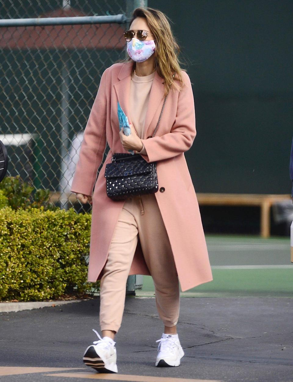<p>Jessica Alba leaves a tennis lesson in a blush pink sweatsuit on Sunday in L.A. </p>