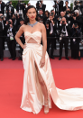 <p>At the premiere of 'Burning', Adriana Lima wowed on the red carpet wearing a cut-out satin dress in a gorgeous champagne hue. [Photo: Getty] </p>