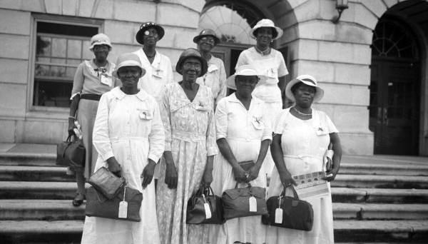 """In the 1930s, the school then known as Florida A&M College began offering a training program for Southern midwives — mostly older African American women — to accommodate a new state law requiring licensure for traditional birth attendants. Many historians believe the legislation was aimed at eradicating midwifery. Shown are midwife trainees in Tallahassee, circa 1935. <span class=""""copyright"""">(Florida Memory)</span>"""