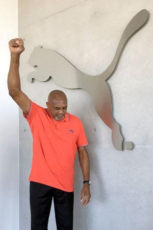 "Tommie Smith, the U.S. sprinter who raised a ""black power"" fist after winning the 1968 Summer Olympics - Men's 200 metres and never competed again poses at the Puma Headqaters in Herzogenaurach, Germany September 18, 2018. REUTERS/Emma Thomasson"