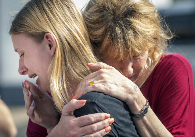 <p>Santa Fe High School student Dakota Shrader is comforted by her mother Susan Davidson following a shooting at the school on Friday, May 18, 2018. Shrader's friend was shot in the incident. </p>