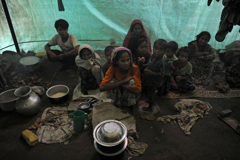 Muslim Rohingyas sitting inside their collective tent at the Dabang Internally Displaced Persons camp