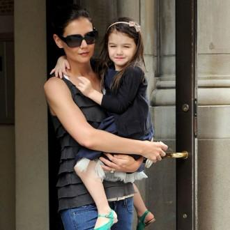 Katie Holmes wants to see the world with Suri