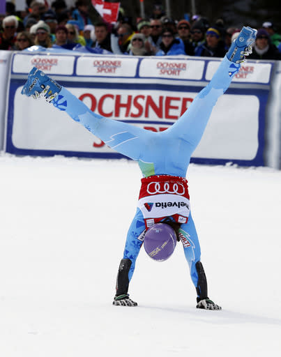 """FILE - In this Sunday, March. 17, 2013, file photo, Slovenia's Tina Maze cartwheels after winning the women's alpine skiing giant slalom at the World Cup finals in Lenzerheide, Switzerland. The biggest puzzle in Alpine skiing approaching the Sochi Olympics was working out what happened to Tina Maze. After her historically good 2012-13 season, 11 World Cup wins, record points total, one world championships gold medal , the 30-year-old Slovenian fit perfectly as a potential Winter Games star. Maze celebrated victories with her exuberant trademark, a cartwheeling handspring across the snow. This season, she was clearly unhappy as her winless streak stretched into January, unwilling or unable to explain what she described in her blog as """"mediocre results."""" All that changed last Saturday, Jan. 25, 2014, when Maze raced to an elusive first win in a downhill at Cortina d'Ampezzo, Italy. (AP Photo/Alessandro Trovati, File)"""