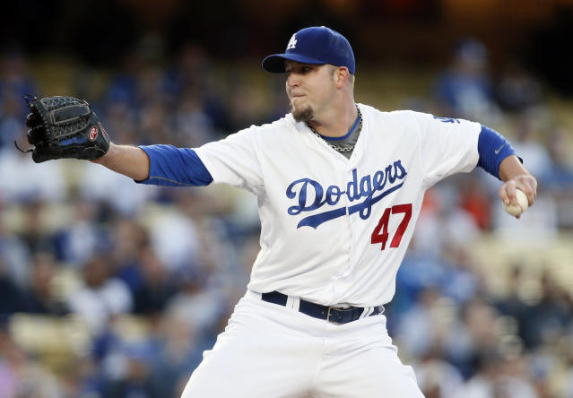 Los Angeles Dodgers starting pitcher Paul Maholm delivers against the San Francisco Giants during the first inning of a baseball game , Friday, May 9, 2014, in Los Angeles. (AP Photo/Danny Moloshok)