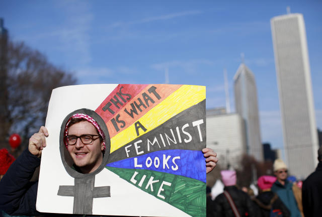 <p>A man holds up a sign as he takes part in the Second Annual Womens March Chicago on Jan. 20, 2018 in Chicago, Ill. ((Photo: Jim Young/AFP/Getty Images) </p>