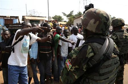 Angry men point at AU soldiers at Gobongo district in Bangui