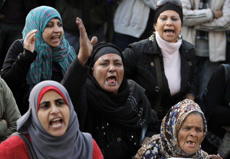 Egyptian protesters shout anti-Muslim Brotherhood slogans during a protest in Tahrir Square to mark the second anniversary of former President Hosni Mubarak's resignation, in Cairo, Egypt, Monday, Feb. 11, 2013. Egypt has witnessed a fresh cycle of violence over the past weeks since the second anniversary of the 2011 revolution that deposed longtime autocrat Hosni Mubarak, with clashes across the country having left scores dead and hundreds injured. (AP Photo/Amr Nabil)
