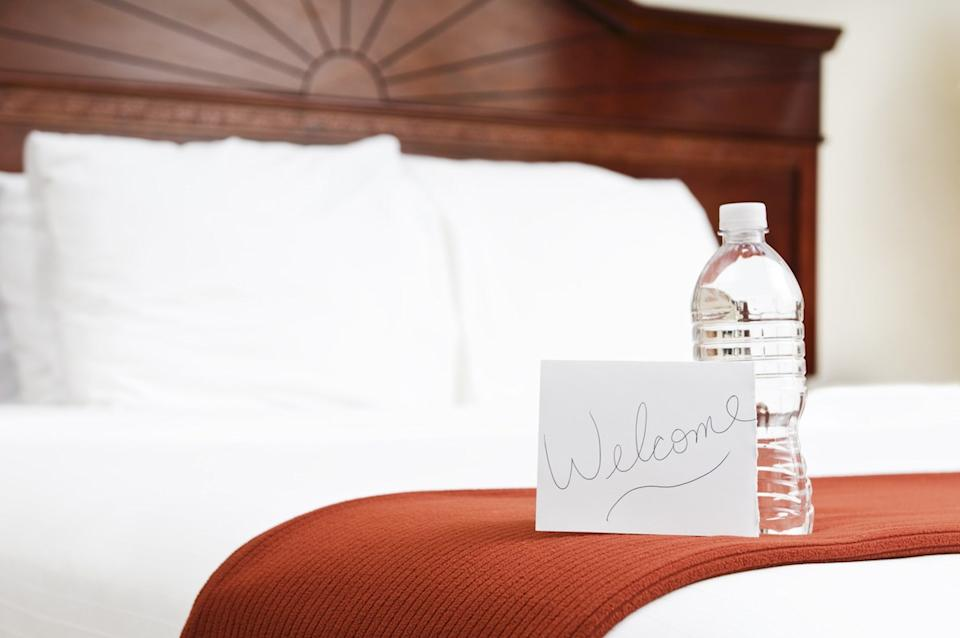 Hotel room with water as a welcome gift