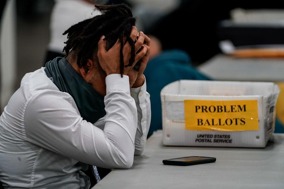 A Board of elections worker takes a quick break after processing ballots