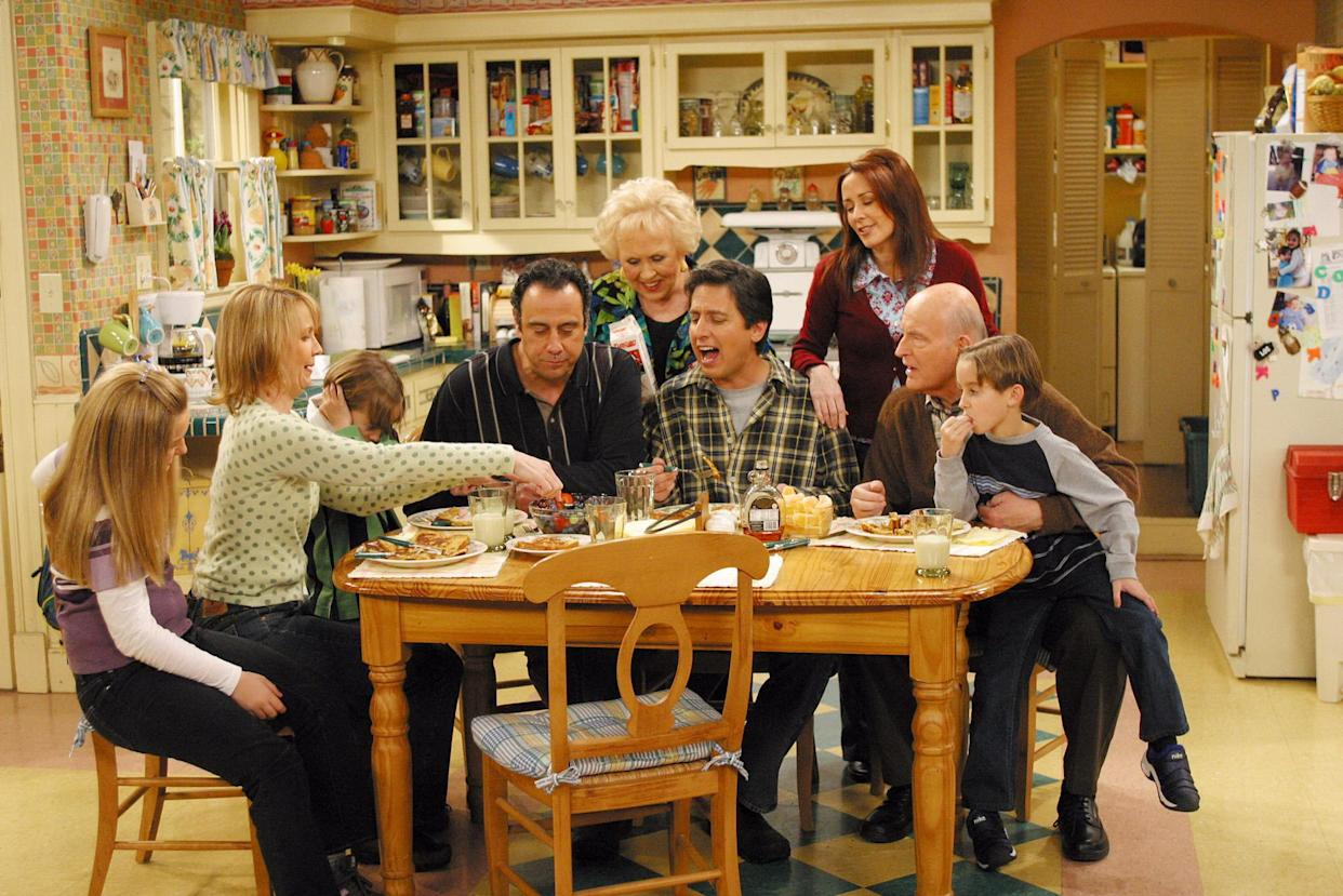 LOS ANGELES - APRIL 16:  The Barone family enjoys Marie's home cooking on the May 16 series finale of EVERYBODY LOVES RAYMOND.  From left to right:  Madlyin Sweeten, Monica Horan, Sawyer Sweeten, Brad Garrett, Doris Roberts, Ray Romano, Patricial Heaton, Peter Boyle, Sullivan Sweeten.  (Photo by Robert Voets/CBS Photo Archive/Getty Images)